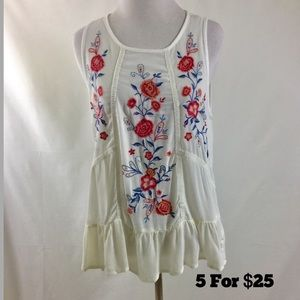 Sleeveless Embroidered Top with Ruffle.